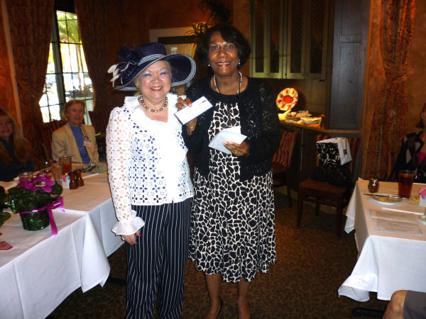 Denyse presents check to Monique Sajous for Haiti earthquake victims