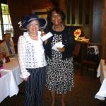 Denyse presents check to Monique Sajous for Haiti earthquake victims
